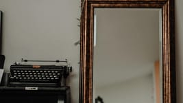Why You are the Story in Business Storytelling typewriter and mirror