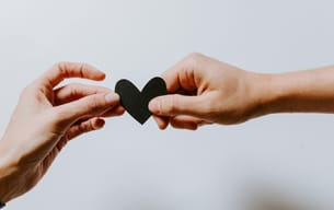 Why a Book Writing Coach Is a Therapist for Your Book hands holding a heart