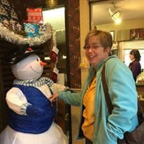 Sheila Trask laughing with fake snowman